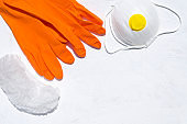 Protective gloves, cap, respirator on the white background. Special tools for safe work