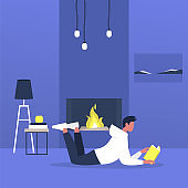 Young male character lying on a floor next to a fireplace and reading a book, modern living room interior