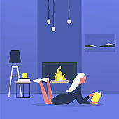 Young female character lying on a floor next to a fireplace and reading a book, modern living room interior