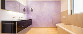 Bathroom with modern black sink and lilac wall