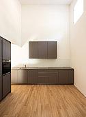 Modern minimalist dark kitchen with parquet.