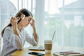 Businesswoman is busy with her work, Worried about her job.