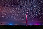 Wind turbines and star trails at night