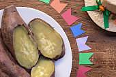 Sweet potato on a rustic table. It is present in all the Juninas Festivals (Saint John, Saint Peter and Saint Anthony). Northeastern tradition. Close-up.