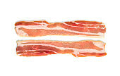 A slice of bacon on a white background. Two raw bacon closeup on a white background.