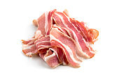 Slices of bacon on a white background. Raw bacon closeup on a white background.
