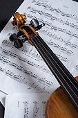 Close-up photo of vintage violin with bow and musical notes. stock photo