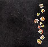 Japanese sushi set on black stone background