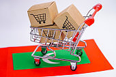 Box with shopping cart logo and Maldives flag : Import Export Shopping online or eCommerce finance delivery service store product shipping, trade, supplier concept.