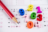 Math Number colorful and pencil on Answer sheet background : Education study mathematics learning teach concept.
