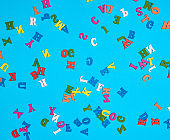 multicolored English alphabet letters on a blue background