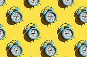 Blue alarm clock pattern on yellow background.