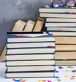 empty notebook with white sheets and many different books