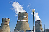Atomic Energy. Atomic reactor. Operating nuclear power plant. Smoke from the chimney, blue sky. Power Generation