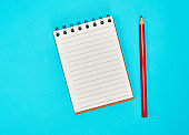 empty rectangular notepad and wooden red pencil