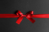 Red ribbon bow on black