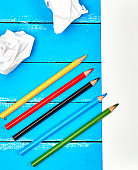 multicolored wooden pencils on blue background