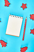 notebook with empty white sheets in line and red wooden pencil