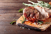 Oven-baked pork with rosemary and spices.