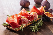 Figs with prosciutto and rosemary.