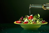 Green salad with  tomatoes, sesame and walnuts.