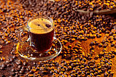 Espresso coffee cup with coffee beans.
