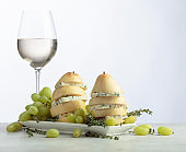 Blue cheese with pear and glass of white wine.