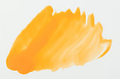 Glossy yellow paint stain isolated
