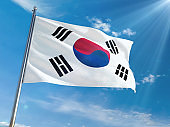 South Korea National Flag Waving on pole against sunny blue sky background. High Definition