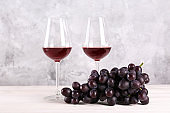 Rustic composition with vintage wine over textured wall background.