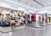 Various women's summer clothes displayed in retail in the clothing store