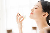 Asian girl with perfume