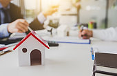 Real estate broker and customer signing a contract. Trading house for rent and insurance.
