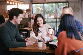 people talking happy in cafe