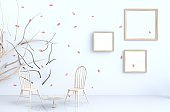 White room background decor with blow pink leaves, branch,picture frame, chair. 3d render. For valentine day and love day.