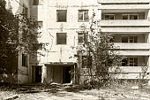 The ruins of residential buildings, the dark trash of collapsed houses as a result of the economic crisis and earthquake. The interior of the old buildings is destroyed.