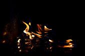 Fire flame burning plastic on black dark background