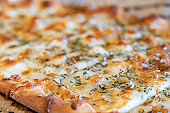 A classic dish from Turkey's rich cuisine.close up ready to eat turkish pide with cheddar cheese