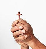 black man praying hand with crucifix cross