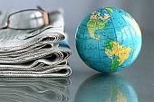 newspaper with globe