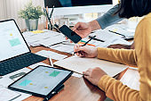 Teamwork process, Young designers planning work together on website ux app development.