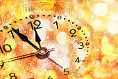 Five minutes to twelve. Christmas and New Year background with a Roman clock, holiday eve against the background of bright lights with a side. Banner for text, screen saver,