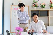 Young man designers planning work together on website ux app development.
