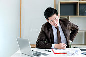 Young businessman at work feel back pain from sit the work.