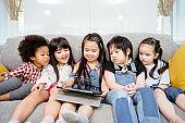 children watching cartoon on digital tablet.