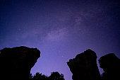 Milkyway stars galaxy over dark stone in Thailand