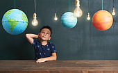 Child learning about planets and space