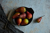 organic pears in a plate on a dark background