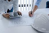 Colleagues interior designer Corporate Achievement Planning Design on blueprint Teamwork Concept with compasse.