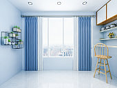 Large windows and curtains in modern living rooms of urban residential buildings